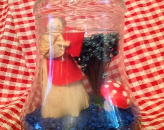 vintage 70's corn husk doll reading in clear glass liberty bell shaped apothecary jar with star flowers & mushroom
