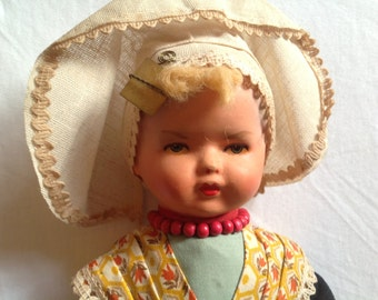 Rozetta plaster and painted vintage doll in Holland costume