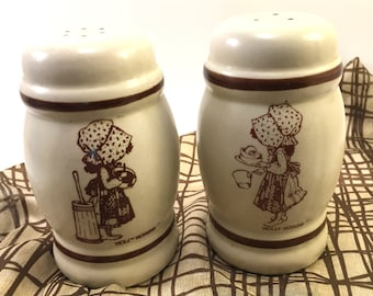 Pair Holly Hobbie salt and pepper shakers vintage 1970's ceramic pottery brown and beige with stoppers