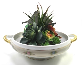 Faux succulent floral plant arrangement in Bavarian floral and gold china casserole with mother & baby bird wood cut