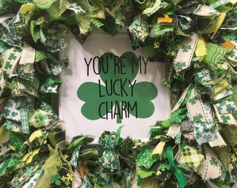 "St. Patrick's Day rag wreath fabric and ribbon round 14"" metal frame on enamel metal sign ""You're My Lucky Charm"" & shamrocks"