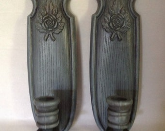pair of wall candle sconces blue gray faux wood country folk art look with rose and leaf motif turned holder marked The Burwood Prod. l987
