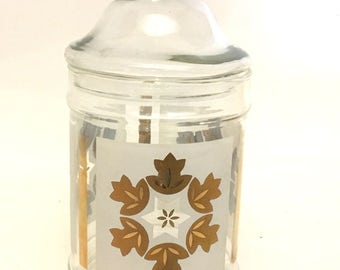 Vintage clear glass apothecary vanity storage jar white and metallic copper mid-century painted folk art flower and leaf design