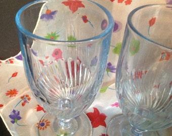 set of 4 vintage clear light blue glass footed base swirl design