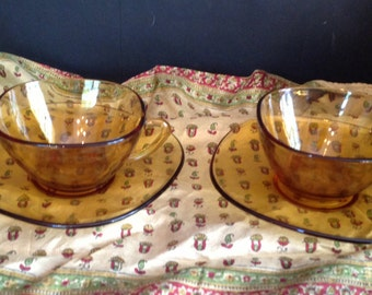 serves 8 glass cup and saucer set marked Arcoroc FRANCE in amber yellow
