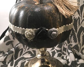 Choice black halloween distressed craft pumpkin on silverplate candle holder stand with decorative trim ribbon roses tassel charms & BOO tag