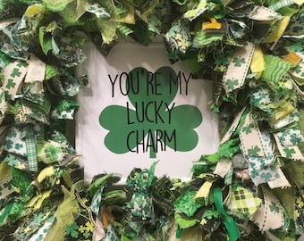 """St. Patrick's Day rag wreath fabric and ribbon round 14"""" metal frame on enamel metal sign """"You're My Lucky Charm"""" & shamrocks"""