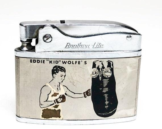 "1950s Eddie ""Kid"" Wolf's Bar and Lounge Advertising Lighter"