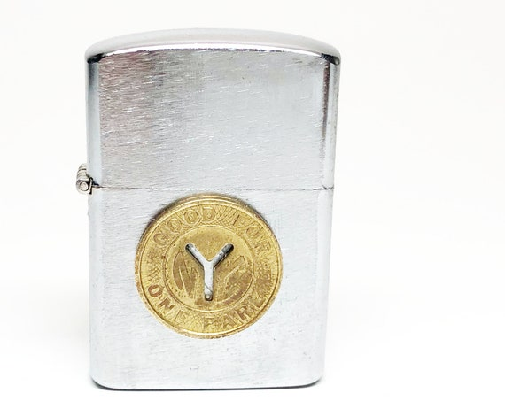 1960s penguin Lighter with NYC Subway Token