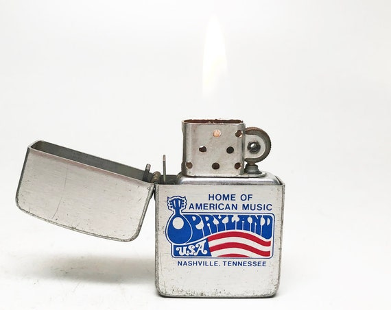 OPRYLAND NASHVILLE LIGHTER - Working Old Storm King Grand Old Opry Country Music Tennessee Flip Top Pocket Lighter