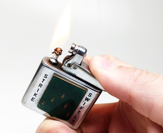 """70th Regiment Army 1940s """"Strike Swiftly"""" Lighter"""