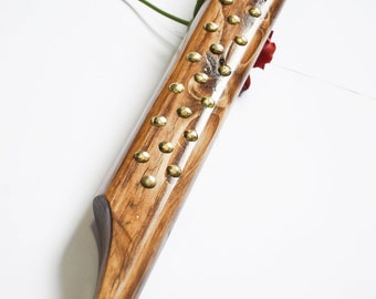 Long, thick, studded spanking paddle - naturally oiled and then sealed with brass studs.
