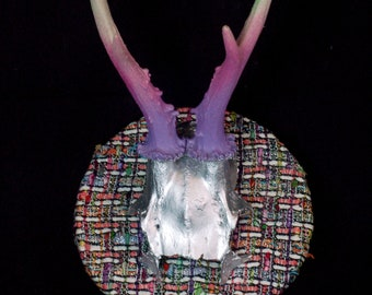 Hand painted roe deer skull in metallic silver  on a beautiful fabric plaque