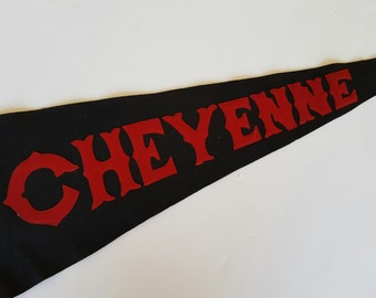 Vintage near perfect wool felt pennant circa 1950's Cheyenne in crimson letters on black pennant. State Pennant