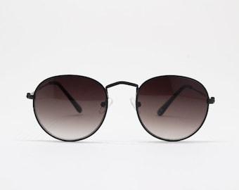 af1c57d8040 Round metal sunglasses. Refined aviator style eyewear