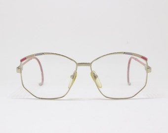efc552780e3 Original 80s vintage NOS pink and gold coloured stylized eyeglasses with  wraparound ear bends. Spectacles