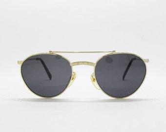 c51a89e06e005 80s vintage sunglasses