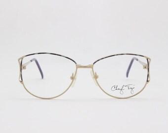 6e9c87d1713 80s vintage glasses. NOS. Prescription designer eyeglasses by Cheryl Tiegs.  Stylised marbled enamelled spectacles. Frame made in Japan.