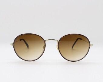 a5cc45e2b79 Original 90 s refined aviator style metal sunglasses with brown lenses.