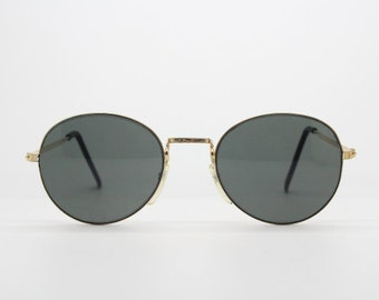 1ee66e227a8 90s vintage sunglasses. NOS refined aviator. Metal frame with dark green  lenses