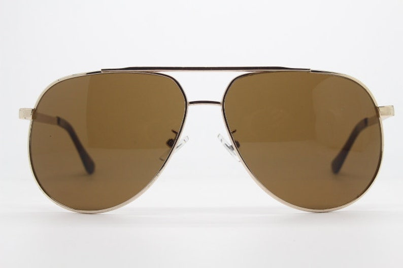 b37cab3e2e Vintage 70s aviator sunglasses. Golden metal frame with brown