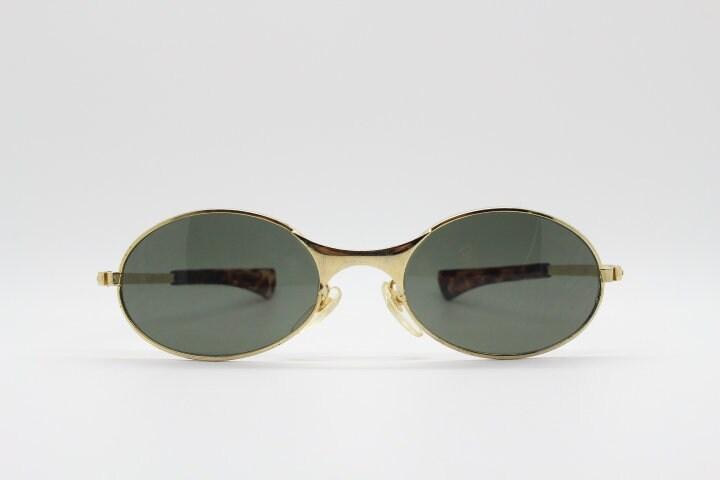 Gafas de sol ovaladas vintage de los años 90. Mini ojo de mini