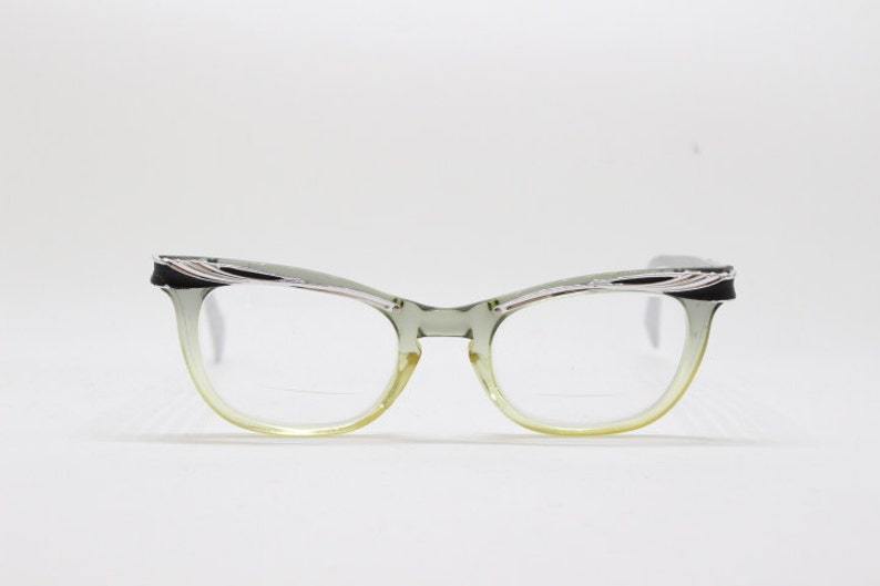 ff5277ca8f04 Original 1950s vintage black and silver cat eye spectacles.