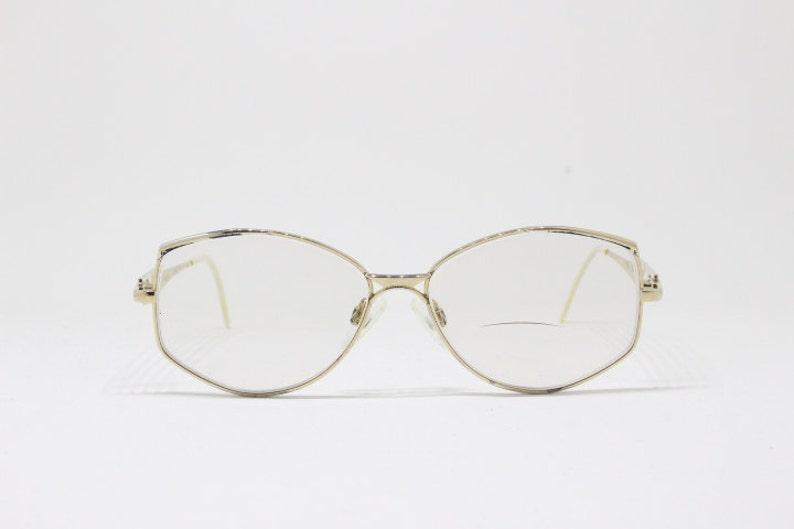 286eaedde6 Original 80s stylized vintage glasses. Gold coloured angular