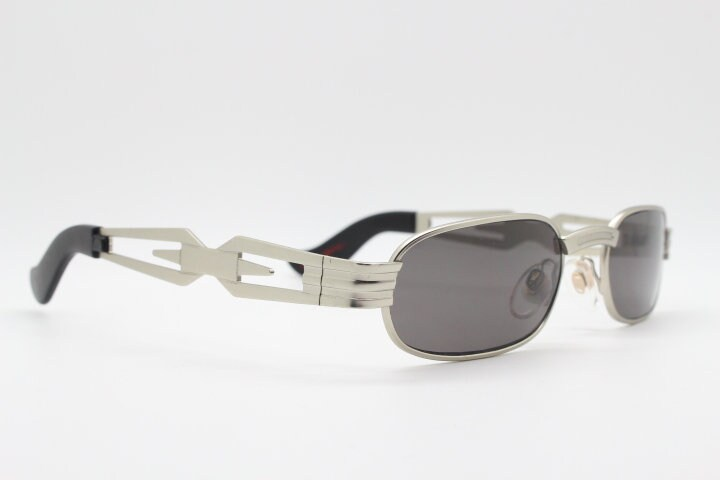 90s vintage sunglasses by Collection Privee Paris. Brushed