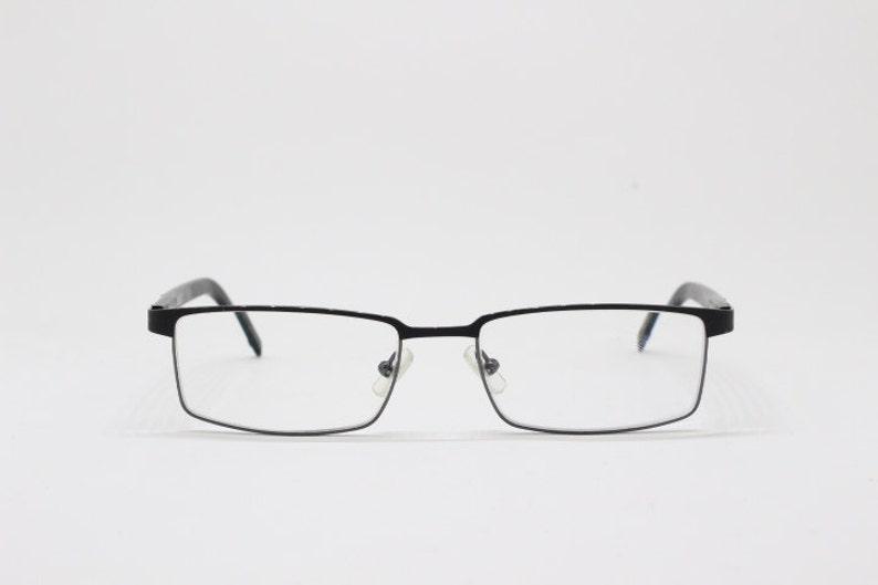 b35b07441f28 Karl Lagerfeld eyewear 90s style glasses slim black metal
