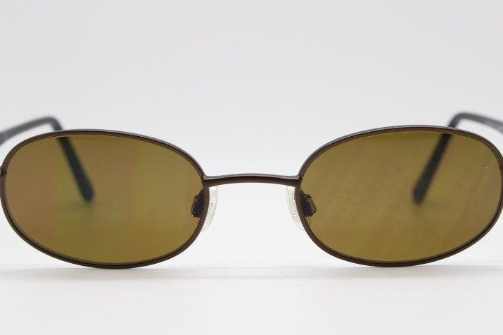 90s vintage oval sunglasses by Enjoy model E3718. Brown metal