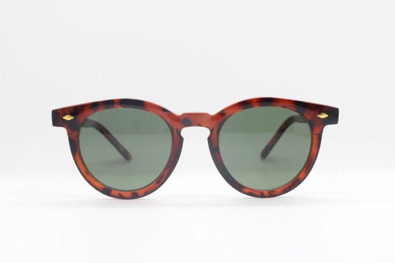 d1271c12e4e7 90s vintage sunglasses. NOS tortoise round frame with green