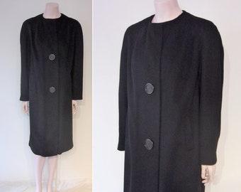 "Chic 1960s black coat w/oversized buttons, simple sleek shape Bust 38""-40"""