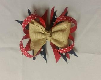 khaki, red, blue bow