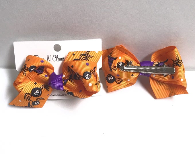 Spiders on orange halloween hair bow clip