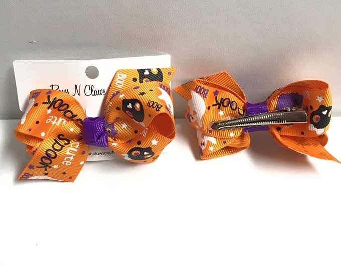 Skulls and ghost to cute to spook on orange hair bow clip