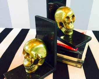 Brass Skull Bookends with Sparkling Black Marble Frames.