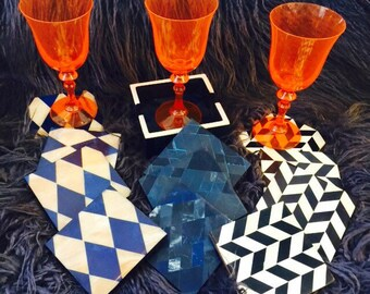 Chic 4 Piece Coaster Sets in Choice of Bone Diamond Patterns over Wood Bases.