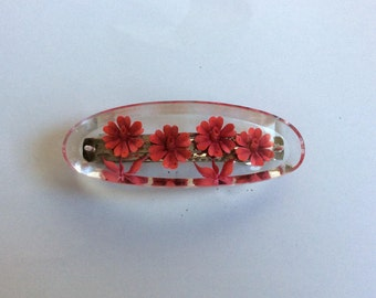 A beautiful hand made resin flower engraved