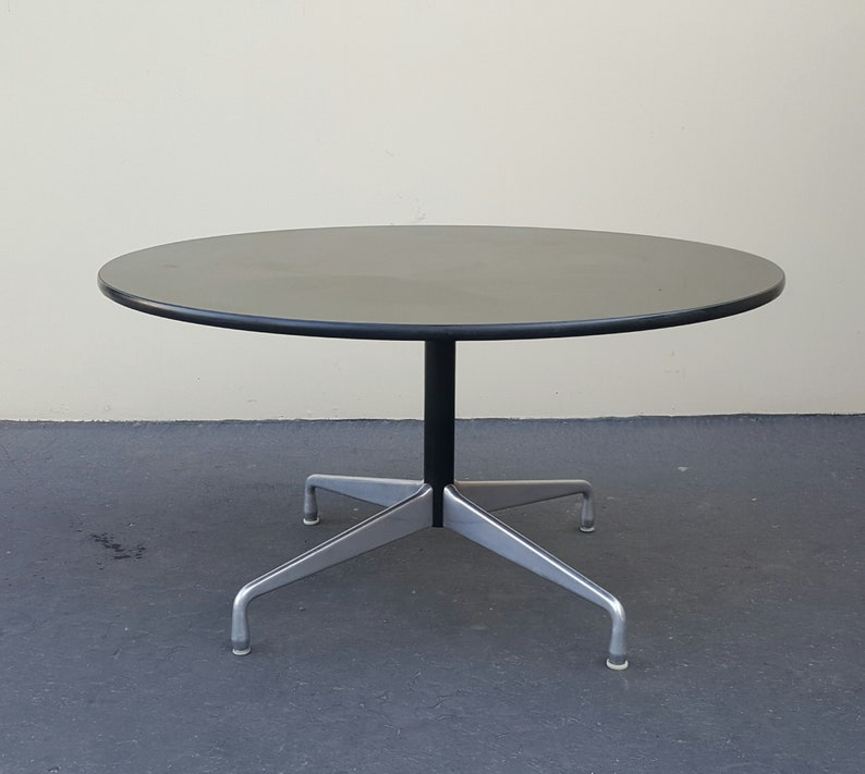 1960s Charles Eames Aluminum Group Round Black Laminate Dining Table  Conference Table By Herman Miller Segmented Aluminum Four Star Base