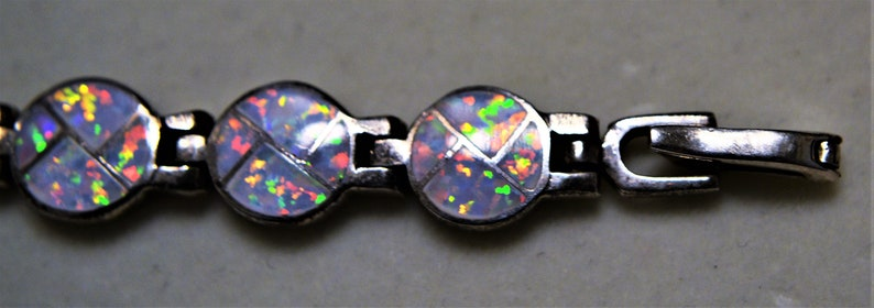Sterling Silver and Fiery Opal Stones Set in a Round Formal Tennis Bracelet