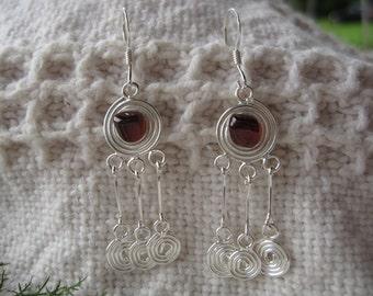 Adirondack Garnet Swirl Earrings: sterling silver swirls with Adirondack garnet on fish hook wires