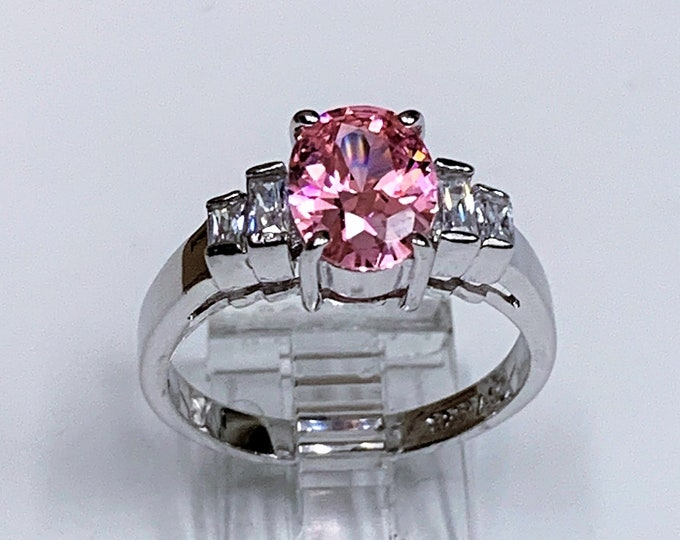 Sterling Silver - Rhodium Engagement Ring, Oval Pink Full Cut CZ 9X7 mm, Accenred with Straight Colorless Baguettes, Size 8 1/4