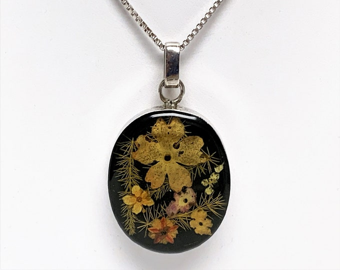 """Natural Petite Colorful Flowers Captured in Clear Resin and Sterling Silver Oval Setting 30X25 mm, 16"""" Sterling Silver Box Chain. 11 Grams."""