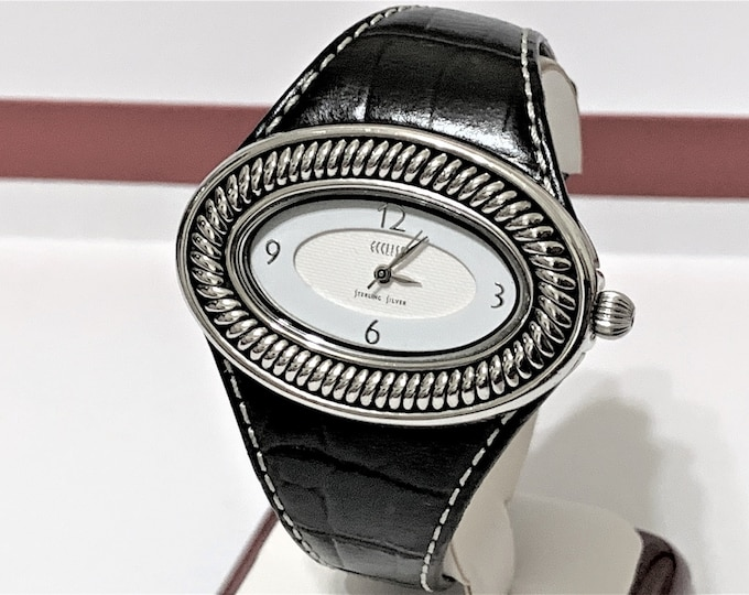 Ecclissi Sterling Silver Cable Style Bezel Unisex Watch 22940, Limited Edition, Black Leather Band, 43mm Oval Case, Serviced and Warranteed.
