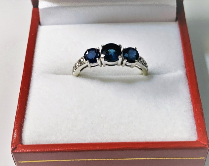 10K White Gold Natural Blue Sapphire & Diamond Ring, Center 5mm - .64 ct. Sides 4mm .70 ct. 6 Diamonds .15 ct. T.W. Size 7. Free US Shipping