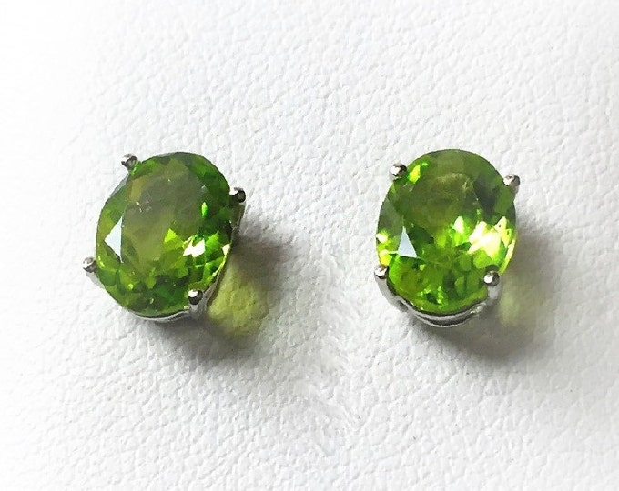 14k White Gold Green Peridot Studs, Natural Top Color Peridot Oval Faceted 8 X 6 mm, Total Weight 2.60 carats.