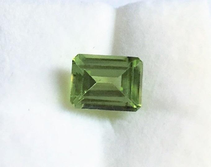 Genuine Natural Green Peridot, Emerald Cut Loose Gemstone, 9.10 X 7 mm, 2.60 carats. Light Olive Green