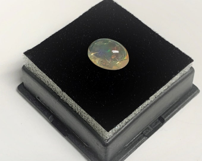 Precious Mexican Fire Opal, Fascinating Honey Color Body with Layers of Colorful Fire, Oval Cabochon 11 X 8 mm, 2.93 carats.