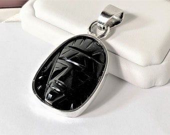 """Black Jadeite Carving of Mayan Face Guatemalan, Sterling Silver Setting, 2.5"""" L - 1.25"""" W, 39.50 Grams, Vintage Hand Made, Leather Cord."""